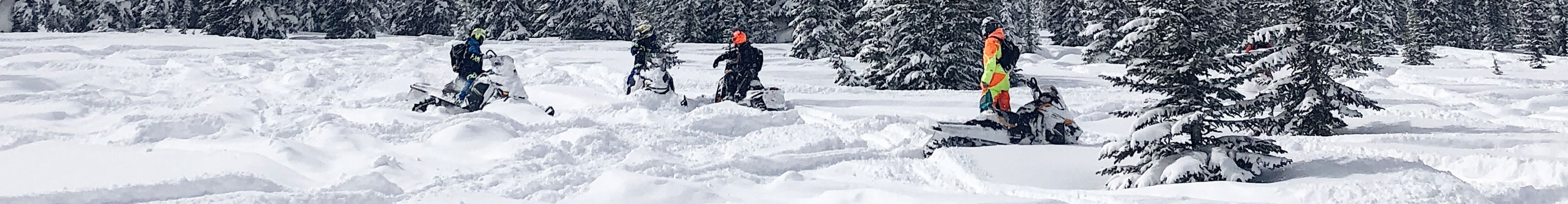 Snowmobilers take a break on a long trip