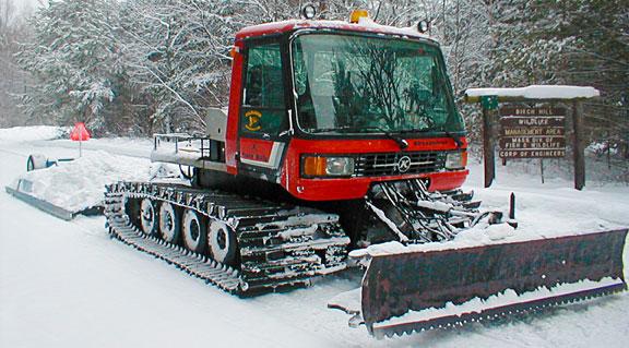Snowmobile trail groomer