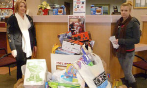 Toys for Tots donations by Snowmobile Association of Massachusetts