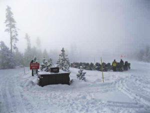 Old Faithful at Yellowstone via snowmobile