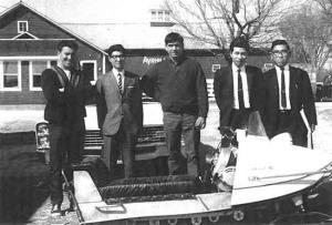 Ronnie Ouimet and Yamaha snowmobile engineers