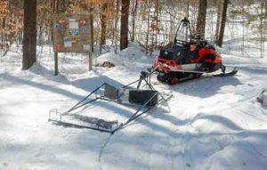 Sn=mall snowmobile groomer