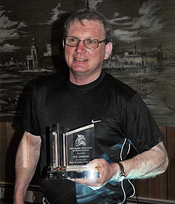 Joe Gibbons accepts the 2014 Trail Worker of the Year Award.